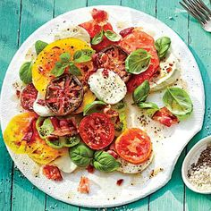 Hot Bacon Caprese Salad | Update the Italian tomato salad with a rich, tart dressing. | SouthernLiving.com