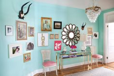 Gallery Wall: Nice display, color and it is spread out, by Caitlin Wilson Design