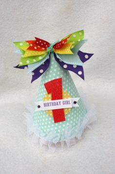 Cute rainbow party hat, put a unicorn on there instead of the year for the party guests. I love the bow on the top