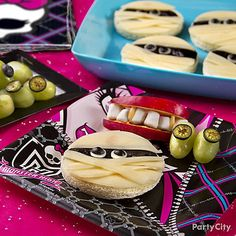 Serve a creepy creation of mummy nori sandwiches with a side of grape eyeballs that's simply to die for!