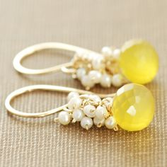 Gold earrings with little bead pearls and yellow stones.