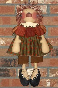 boneca com abóboras