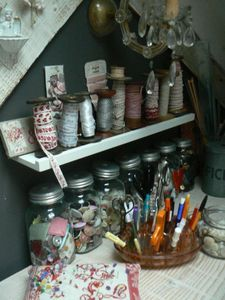 sewing notions storage - Mason jars and vintage spools