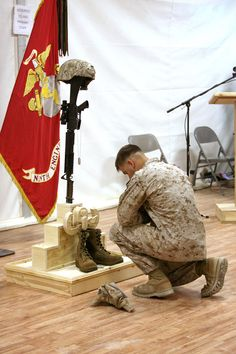 A Marine pays his final respects to Gunnery Sgt. Christopher Eastman, an explosive ordnance disposal technician with 1st EOD Company, 7th Engineer Support Battalion, 1st Marine Logistics Group (Forward) who died July 18 while supporting combat operations in Helmand Province. Eastman, 28, from Moose Pass, AK, enlisted in the Marine Corps in 1999 as a combat engineer. He lateral moved into EOD in 2006 and deployed to Iraq in 2008. He is survived by his wife, Rocio, and daughter, Joy.