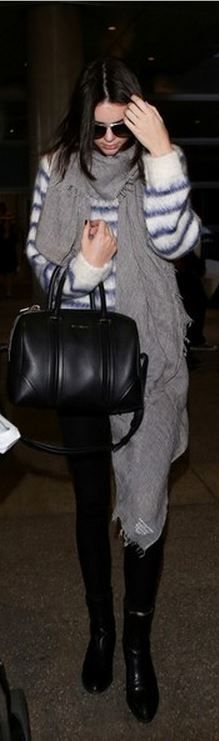 Kendall Jenner: Sweater – H&M  Purse – Givenchy