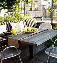 Built-in benches make the most of small-space patios. More ways to improve a small backyard: http://www.bhg.com/home-improvement/porch/outdoor-rooms/improve-small-backyard/?socsrc=bhgpin080312builtinbenchespatio#page=4