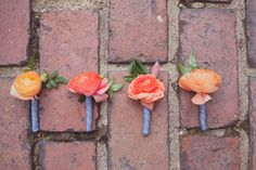 peach toned boutonnieres, photo by Maria Mack http://ruffledblog.com/colonial-dames-wedding #grooms #boutonniere