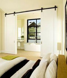 barn doors- white wash- double sliding doors. divide bathroom and master bedroom :)