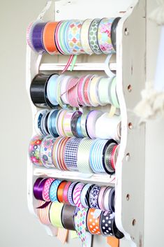DIY Ribbon rack storage. What is that old plate holder or towel holder? Add some dowel rods and you have ribbon storage that is compact.