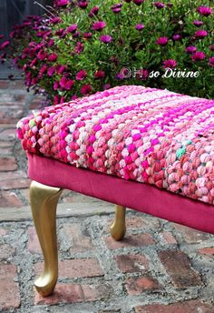 """Bench reupholstered with a rag rug - """"The best part about using a rug to recover the bench is that it's durable and can withstand teenage abuse and more importantly wild colored nail polish spills. Overall the cost of the project was 35 dollars."""""""