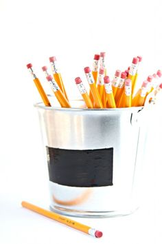 Create a chalkboard pail to keep school supplies organized.