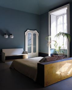 slate grey-blue walls, lots of natural light, built-in millwork and PLANTS galore for my bedroom please