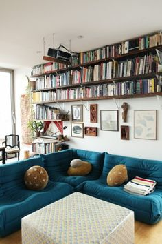 Book shelves and a corner couch