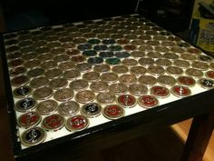 I want to do something like this for Brad. This is like the penny floor, but with tobacco can lids.
