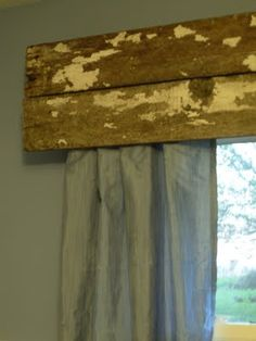 Barn wood valance.  Use (bent) handmade nails to assemble.  Could do nail holes then work in nails with cooked on beads to match curtain colors.  Also, attach old door hardware and let it leave rusted shadows (skip the paint) or could mix in a length of old wooden spindle (might leave some faded stain/paint on it).