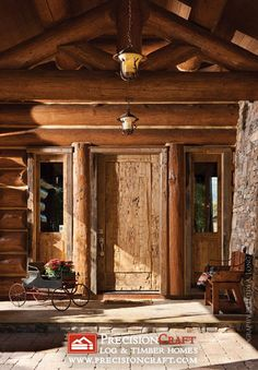 Handcrafted Log Home Entry by PrecisionCraft Log Homes & Timber Frame
