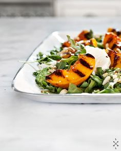 grilled peach salad with mint and basil pesto