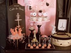 A cute pink and black parisian dessert table... cute for a baby shower!