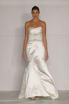 Sheath / column tulle sleeveless bridal gown with empire waist