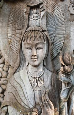 wood carving of Kuan Yin