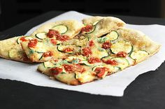 Lovely blend of flavours and textures at work in this delicious Zucchini Bruschetta Garlic Breadcrumb Pizza. #pizza #burschetta #Italian #dinner #meals #flatbread #zucchini #garlic #tomatoes #vegetables #breadcrumbs #vegetarian #food #cooking #delicious