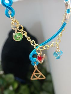 The Legend of Zelda's Wise Ear Bend with Hanging Spiritual Stones and Triforce in Blue on Etsy, $25.00