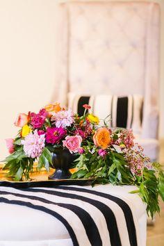 low sprawling centerpiece, photo by Vue Photography http://ruffledblog.com/pattern-play-wedding-inspiration #weddingcenterpieces #flowers