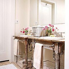 cool shabby table used in bathroom - love the locker baskets too