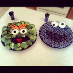 Oscar the Grouch veggie tray and Cookie Monster fruit tray.  (You could substitute strawberries for Elmo.)