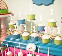 Cute way to display cupcakes using pastry pedestals, paper straws and ric-rac