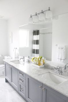 I like this cabinet style (color could be a tad deeper) for master bath with white subway tile in shower and black subway tiles behind vanity    The cabinets are painted in Benjamin Moore's Pigeon Gray. AM Dolce Vito