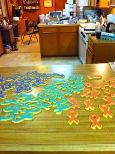 Relay for Life ribbon cookies. Can find ribbon cookie cutter at Hobby Lobby @Jaime Earnhart - this is a neat idea for your last relay- or we could make orange ones for the MS Walk fundraising?