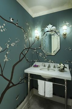 fun guest bathroom idea..    Have the mirror already.     source: Graciela Rutkowski Interiors  Beautiful powder room design with sakura tree wall mural on bold blue walls paint color, marble washstand with polished chrome base, polished nickel faucet & sconces and venetian mirror.    Really like this idea for a bedroom as well