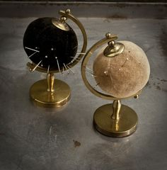 globe pincushions...this could be reproduced by finding globes at garage/thrift sales and then, of course, attatching the ball. hmm.... maybe an idea to hang onto the kids won't be so little so forever.