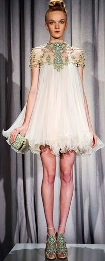This embellished dress by Marchesa is too adorably sexy.