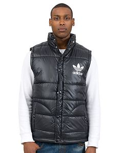 adidas Puffy padded vest Sleeveless design Screen print adidas logo on chest Full zip and snap closure Lightweight for ultimate comfort