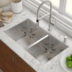 Kraus kitchen sinks are known for sturdy construction and excellent quality. Handcrafted from premium 16 gauge T-304 stainless steel, this undermount sink suits any decor style, from the traditional to the modern kitchen. The extra-deep basin easily accommodates your largest cookware, including baking sheets and stockpots. A rear-set drain provides more usable surface area and storage space under the sink. Commercial grade finish protects the surface from  #KitchenSinkIdeas