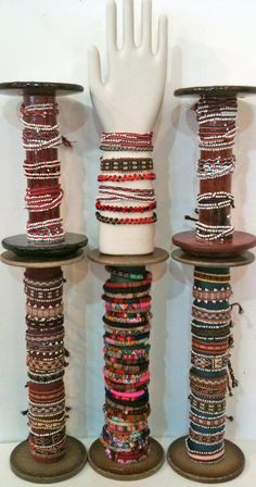 These old Mill Spools and Glove forms are great for displaying bracelets