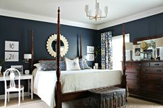 LOVE this master bedroom the dark wood, navy blue walls, with all the white