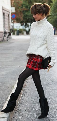 Plaid, fisherman's sweater, tights, and ankle boots.