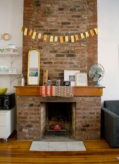 """What to do with our """"out of commission"""" fireplace? - I like the vintage feel of this one."""