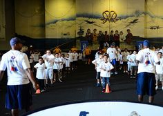 SAN DIEGO (Aug. 28, 2013) Children of Sailors assigned to the aircraft carrier USS Ronald Reagan (CVN 76) participate in the NFL's Play 60 program in the ship's hangar bay.
