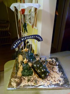 Army Cake complete with paratrooper and star candles!