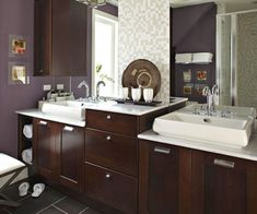 Dark wood in the cabinetry contrasts beautifully wiht the white appliances! More stylish bathrooms: http://www.bhg.com/bathroom/color-schemes/colors/bathroom-color-schemes/?socsrc=bhgpin020314purpleandcoffeebathroom&page=6