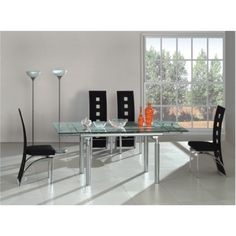 A very elegant Modern tempered glass Dining Table with two extensions & Chrome legs. -- Julianna