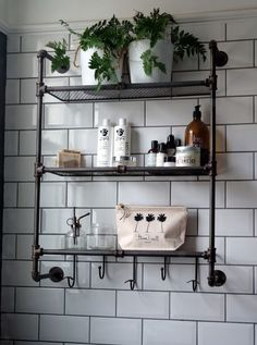 Industrial style shelf against metro tiles with dark grout. Vintage industrial monochrome bathroom