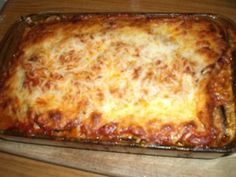 Vegetarian Eggplant Lasagna Slice lg Eggplant 4 batches lightly SAUTE 1 tsp of olive oil each, 1 cup Sauteed Mushrooms.  COMBINE 7oz of Ricotta Cheese ,1 egg,1 Shredded Carrot,1 tsp Basil,1 tsp Oregano LAYER 2 cups Tomato Sauce  Top with1 1/2 cups Shredded Mozzarella Cheese