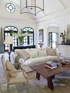 Whats not to like??  White panelling, lantern pendant, round window, palladian transom over doors, vaulted ceiling