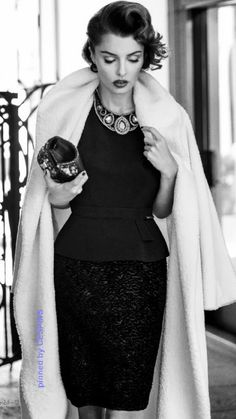 she's very timeless in black and white fashion with statement necklace - - classic and timeless style!