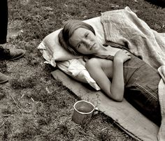 """August 1939. """"Sick migrant child. Washington, Yakima Valley, Toppenish."""" The daughter of migrant laborers harvesting hops in Washington State. by Dorothea Lange"""